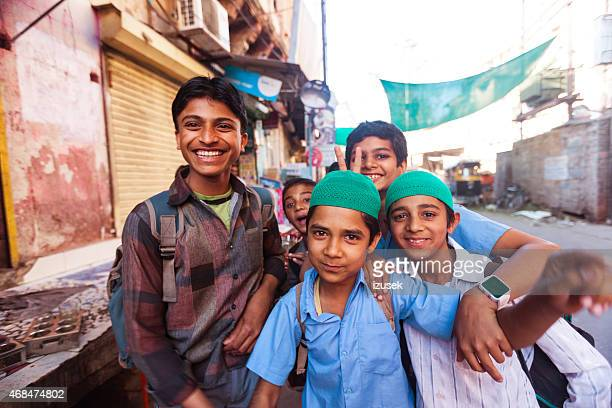 happy indian boys - izusek stock photos and pictures