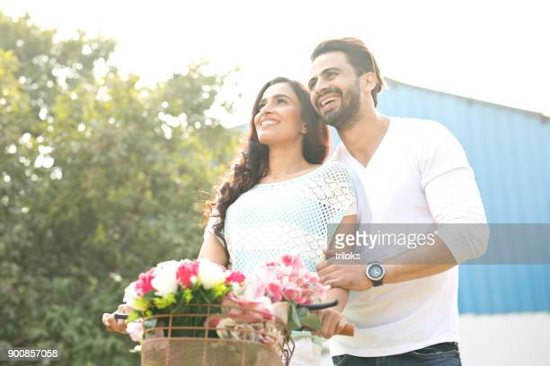 happy indian couple at park - women in girdles stock photos and pictures