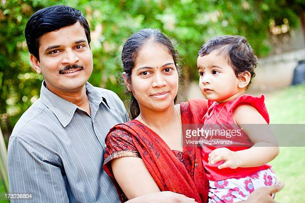 happy indian family of three cheerful young couple - south asia stock pictures, royalty-free photos & images