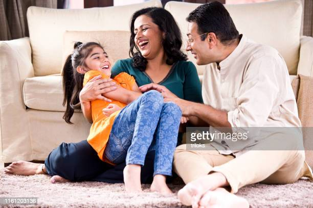 happy indian family - indian ethnicity stock pictures, royalty-free photos & images