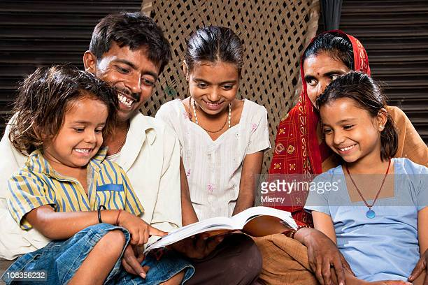 Happy Indian Family Sitting Together Reading A Book