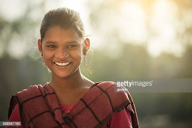 Happy Indian girl giving toothy smile and looking at camera.
