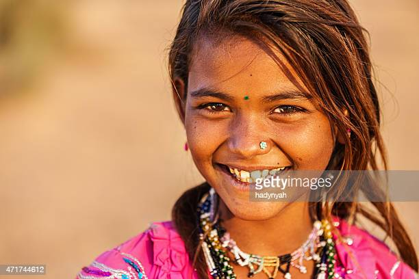 Happy Indian girl in desert village, India