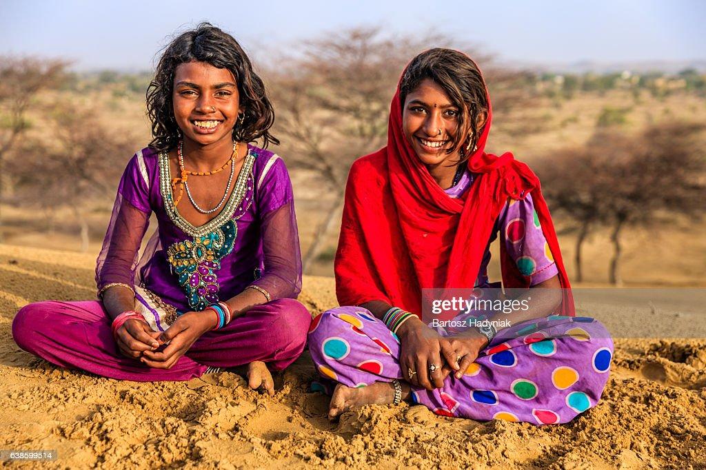 Happy Indian Girls Sitting On Sand Dune Desert Village -6311