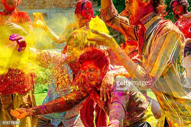 Happy indian people celebrating Holi Festival