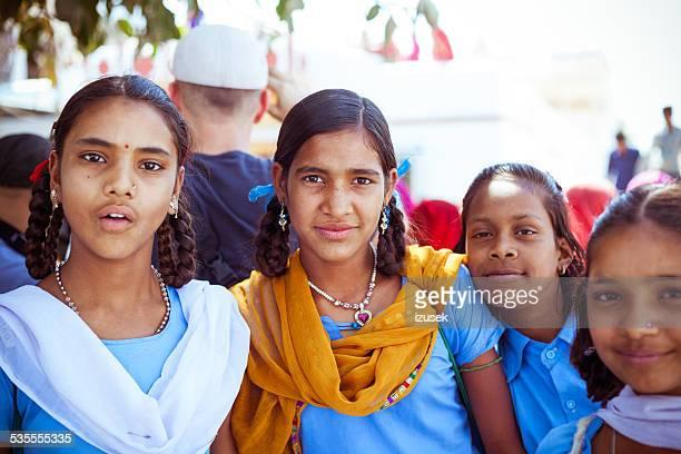 happy indian school girls - izusek stock photos and pictures
