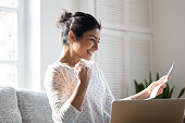 Happy Indian woman reading good news in letter, notification
