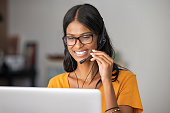 Happy indian woman working in a call center