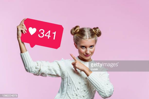 happy instagram influencer holding speech bubble in hand - like button stock pictures, royalty-free photos & images