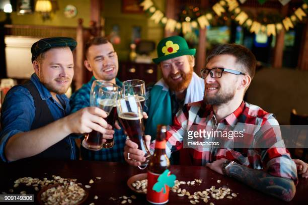happy irishmen spending time in tavern - st patricks day stock pictures, royalty-free photos & images
