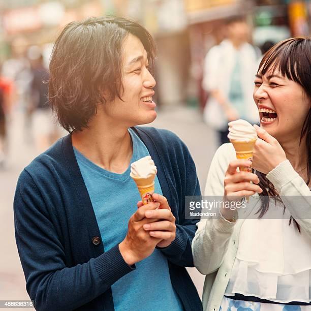 Happy japanese couple eating ice cream