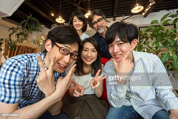 Happy Japanese Family With Peace Finger Signs