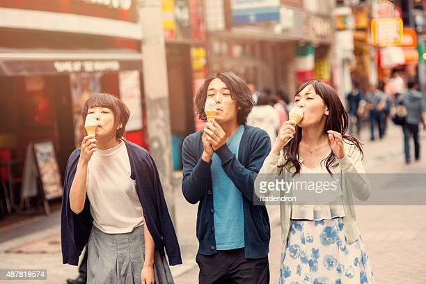 Happy japanese friends eating ice cream