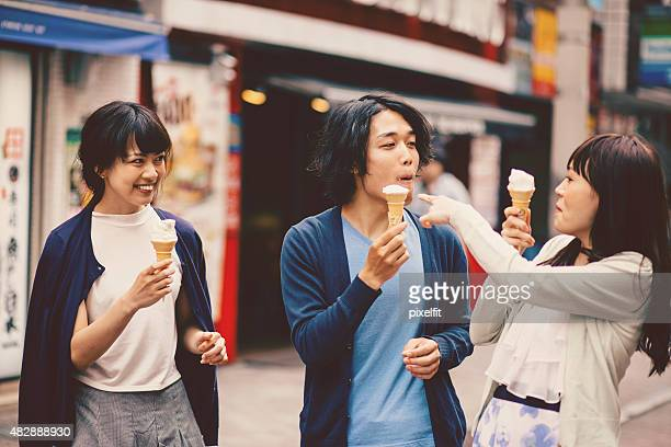 Happy japanese friends outdoors in Japan