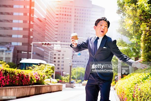 Happy Japanese office worker urban portrait singing in Tokyo street