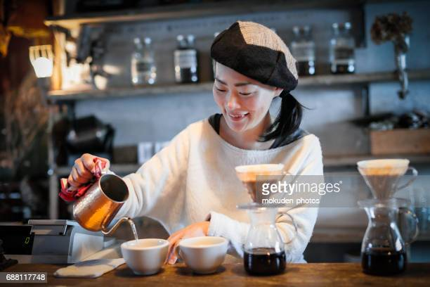 happy japanese woman cafe owner - 経済 stock pictures, royalty-free photos & images