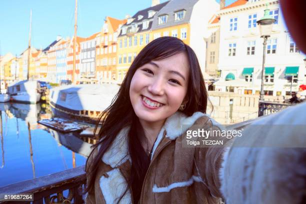 happy japanese woman tourist in copenhagen - self portrait photography stock pictures, royalty-free photos & images