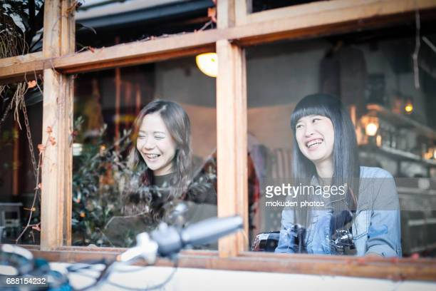 happy japanese womans relaxing holidays at the cafe - 経済 stock pictures, royalty-free photos & images