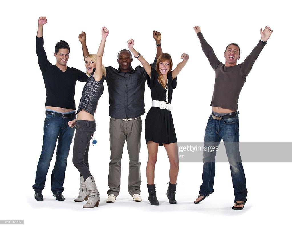 Feliz grupo de salto plantear las manos : Foto de stock