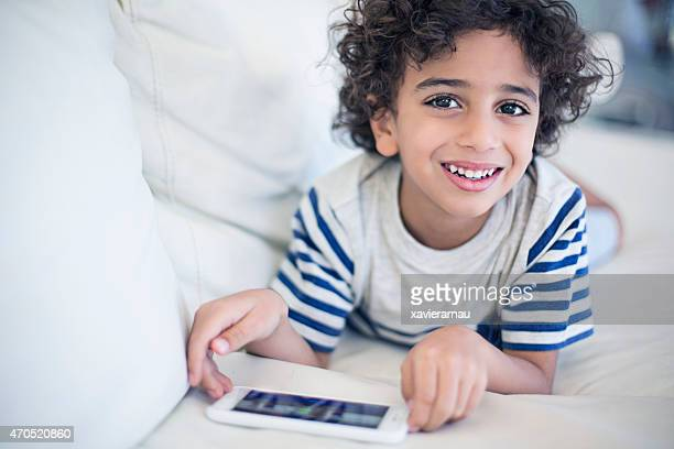 happy kid playing with the mobile phone - boys stock pictures, royalty-free photos & images