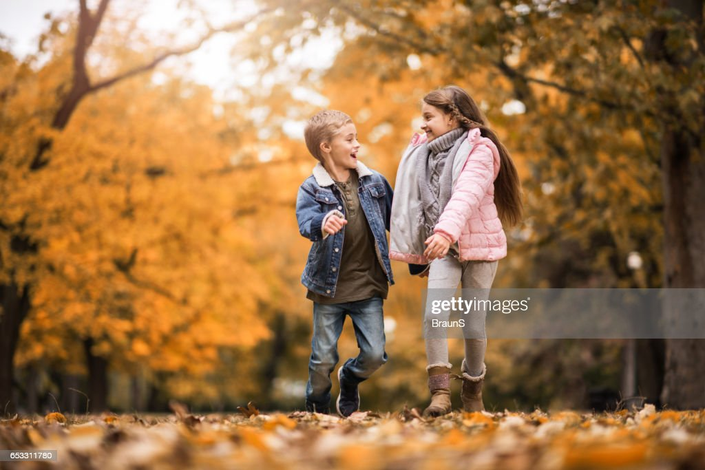 Happy kids having fun while running and talking in nature. : Foto stock