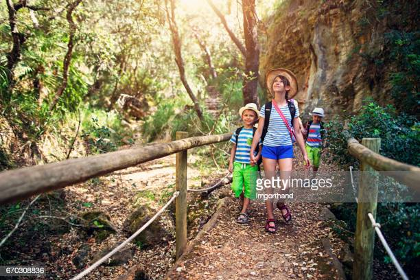 Happy kids hiking in Majorca mountains