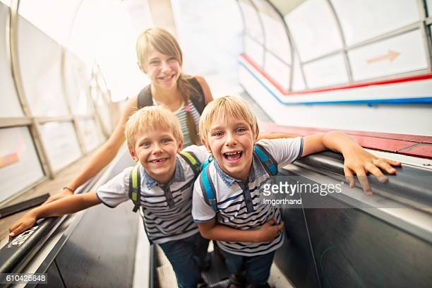 Happy Kids in Rome travelling on escalator