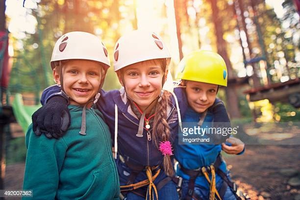 Happy kids in ropes course adventure park
