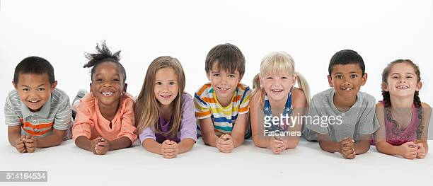 happy kids lying in a row - 8 9 years photos stock photos and pictures