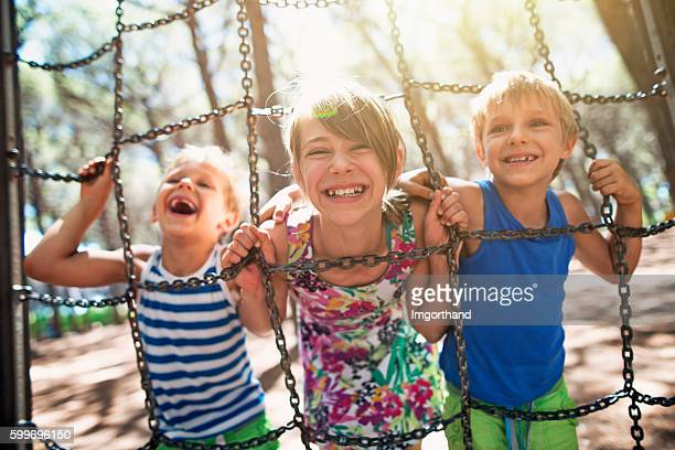 Happy kids playing at the playground