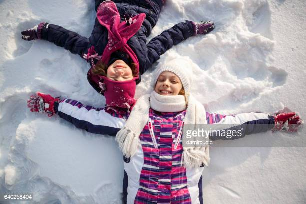 happy kids playing in snow - gennaio foto e immagini stock