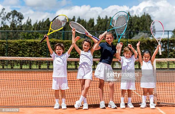 happy kids playing tennis - tennis stockfoto's en -beelden
