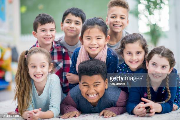happy kids posing together - class photo stock photos and pictures