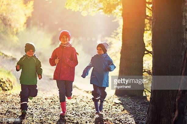 Happy kids running in spring morning