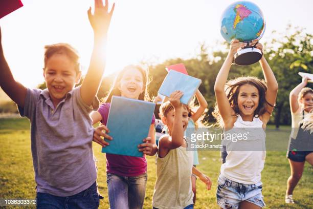 happy kids running on sunset - back to school stock pictures, royalty-free photos & images