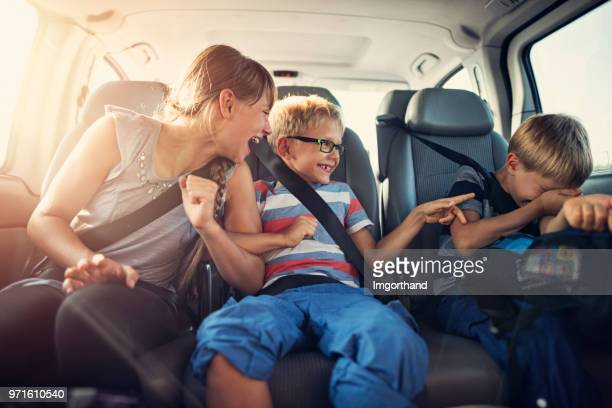 happy kids travelling by car - family inside car stock photos and pictures