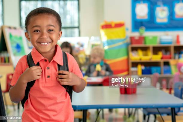 Happy Kindergarten Student in Classroom