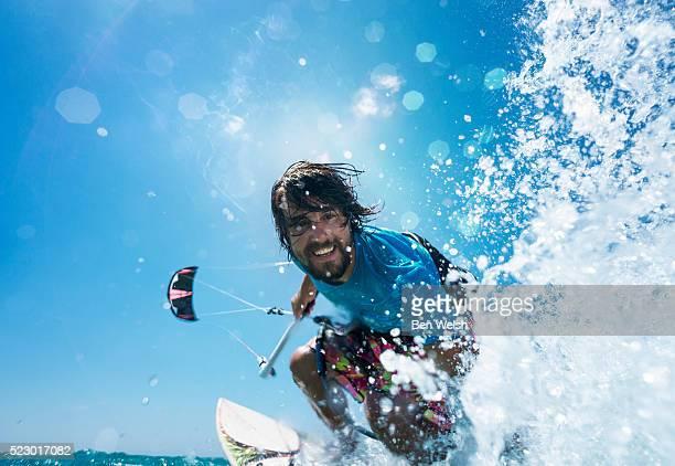 Happy kitesurfer splashing