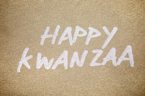 Happy Kwanzaa Message in Silver on Gold Paper 183240786