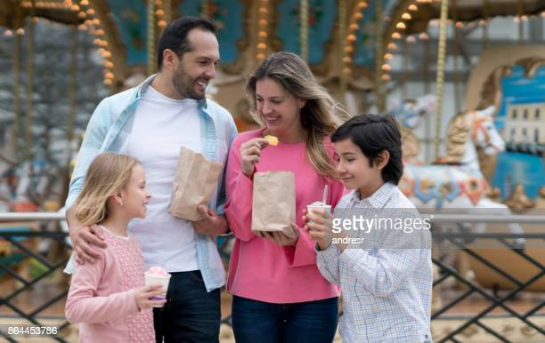 Happy Latin American family having fun at a traveling carnival