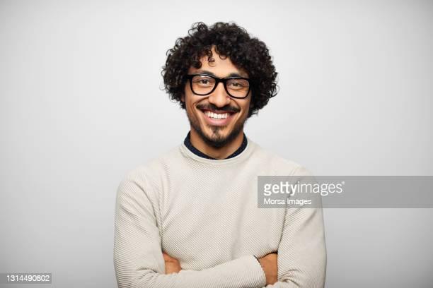 happy latin american man against white background - real people stockfoto's en -beelden