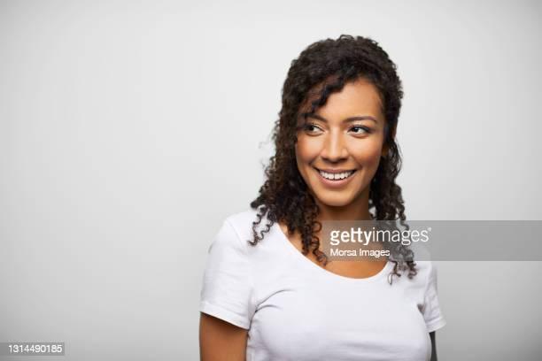happy latin american woman against white background - real people stockfoto's en -beelden