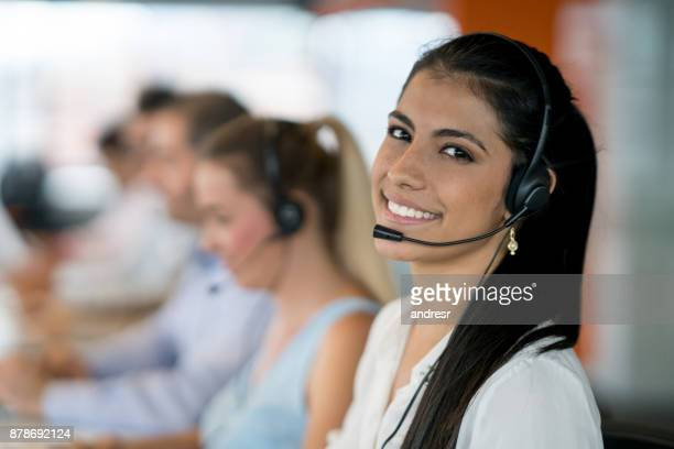 happy latin american woman working at a call center - call center stock pictures, royalty-free photos & images