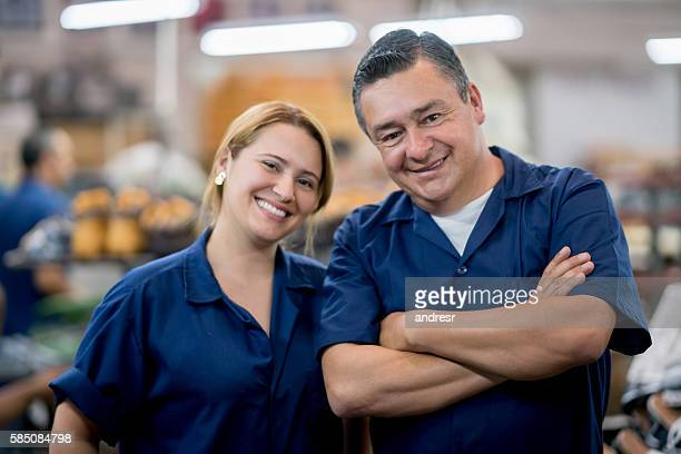 Happy Latin American workers at a factory