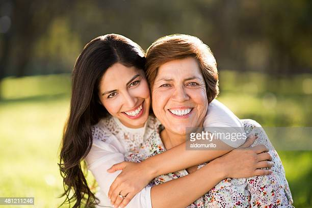 Happy latin mother and daughter