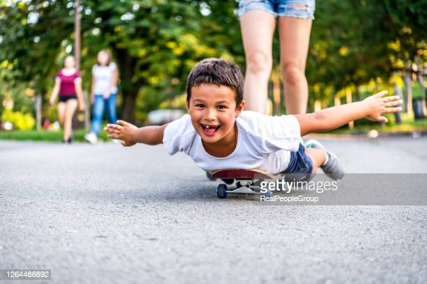 happy laugh, mom woman with little boy son of 8-9 years old, having fun enjoying rest, summer autumn in city park. - 8 9 years stock pictures, royalty-free photos & images