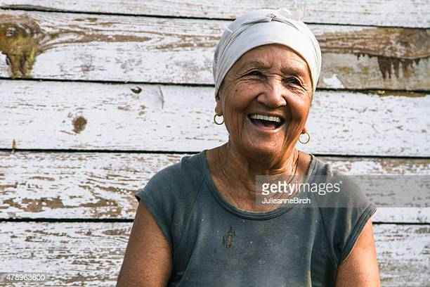 happy laughing cuban lady - human arm stockfoto's en -beelden