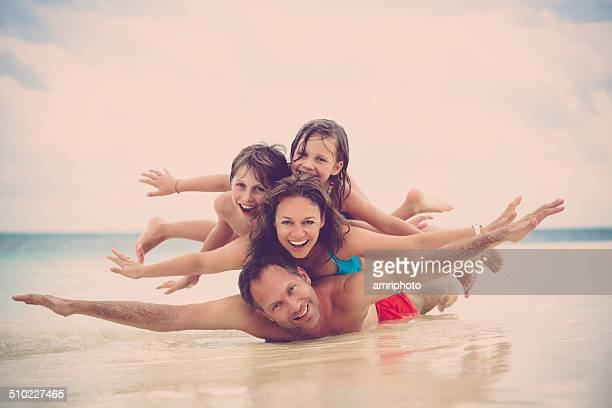 happy laughing family having fun on the beach