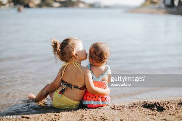 happy laughing toddler girl having fun on sand - kids pool games stock pictures, royalty-free photos & images