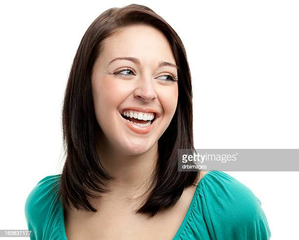 happy laughing young woman looking sideways - sideways glance stock pictures, royalty-free photos & images